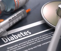 Diabetes - Medical Concept on Grey Background with Blurred Text and Co